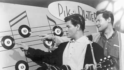 The Pacoima-born Ritchie Valens, left, will have a section of the 5 Freeway named in his honor. Del-Fi Records founder Bob Keane is on the right. (Del-Fi Records)
