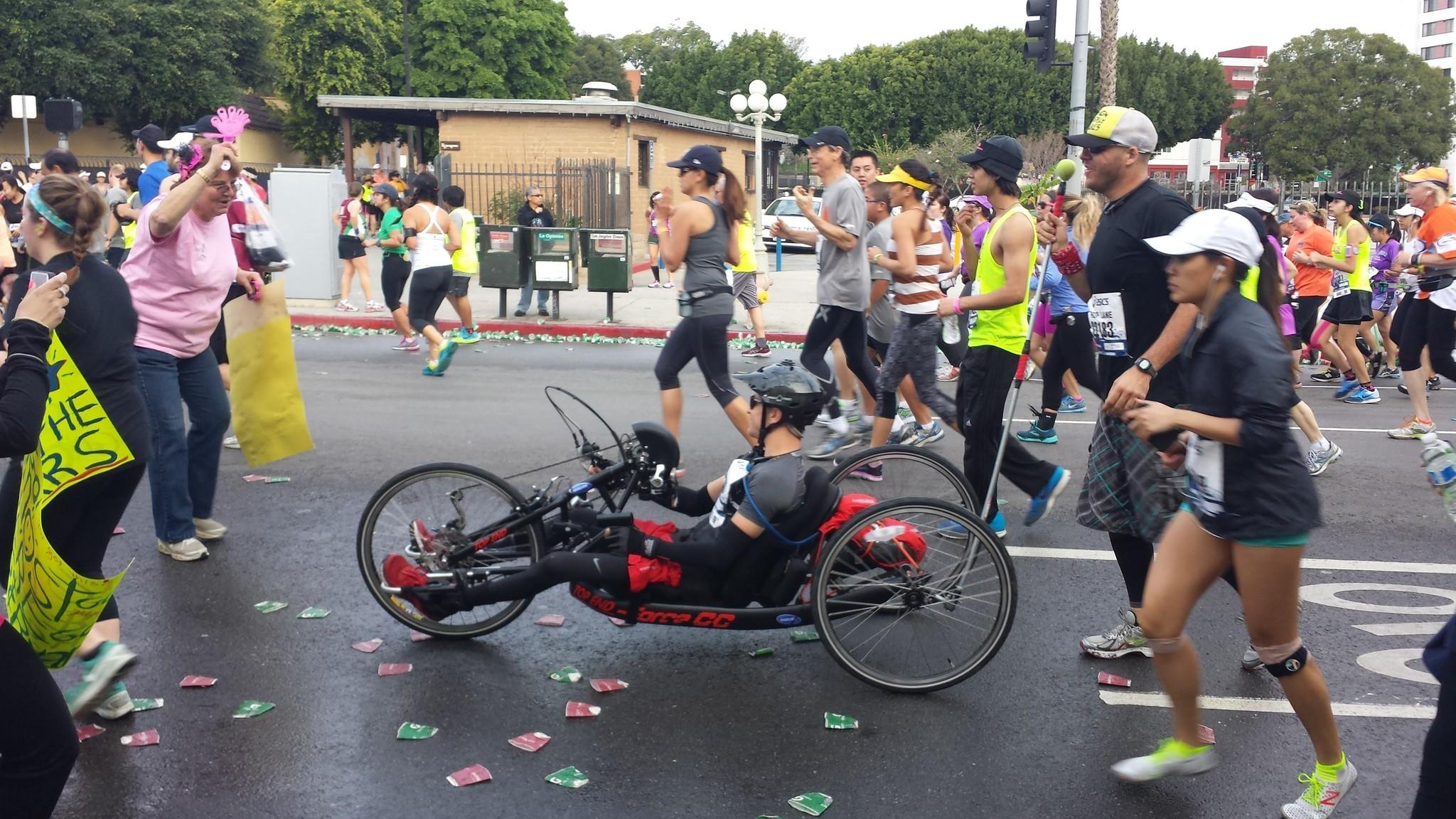 Runners and wheelchair racers make their way through downtown Los Angeles during the L.A. Marathon.