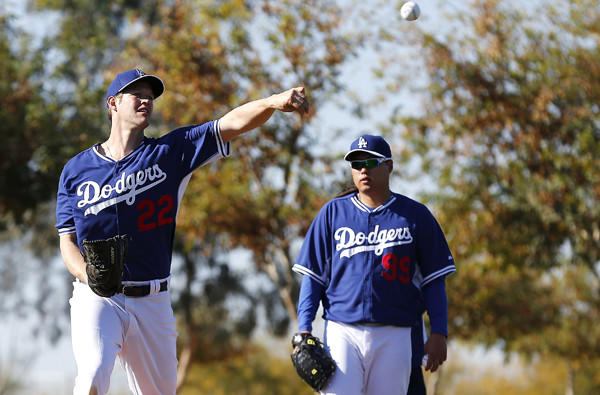 Dodgers ace Clayton Kershaw, left, practices his pick-off move alongside teammate Hyun-Jin Ryu during a spring training workout.