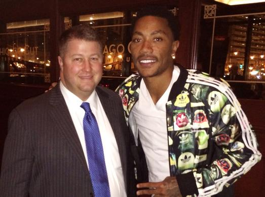 The Bulls' Derrick Rose (right) at Chicago Cut Steakhouse March 8, 2014 with restaurant managing partner David Flom (left).