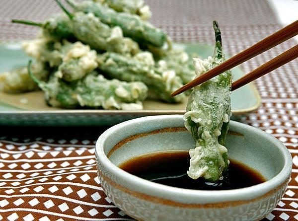 A shishito pepper turned into vegetable tempura gets a flavor boost, courtesy of a sauce.