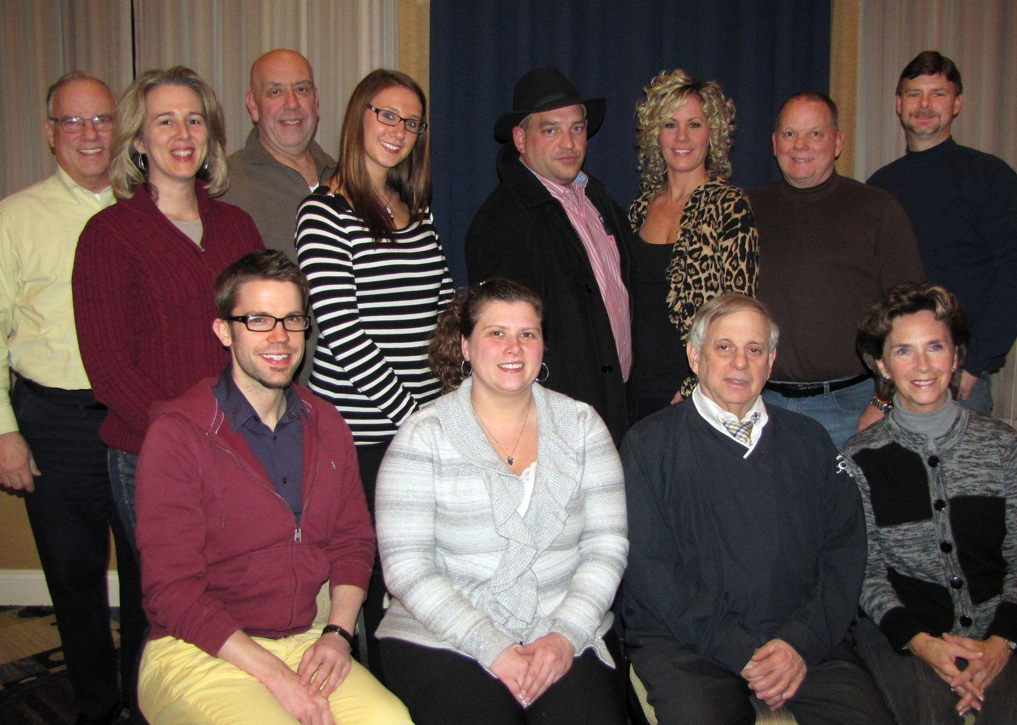 Seated, from left to right: Chad Glabach, Jackie Agruso, John Tinnirella and Gina Filossie. Standing, from left to right: Mike Helechu, Jo Ann Walk, Gary Cote, Carissa Pape, Gary Carra, Michelle Hogan, Rich Tkacz and Dan Leduc. Missing from photo Angela Taylor and Tom Casey.