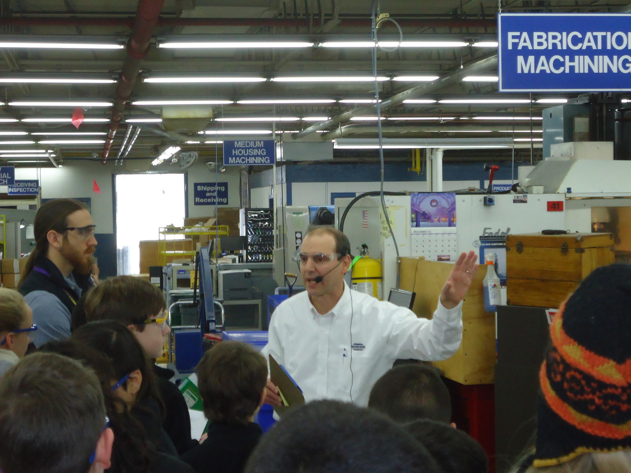 Seventh grade students at the CREC Academy of Aerospace and Engineering tour Birken Manufacturing with Birken Manager of Continuous Improvement, Eric Schneider.