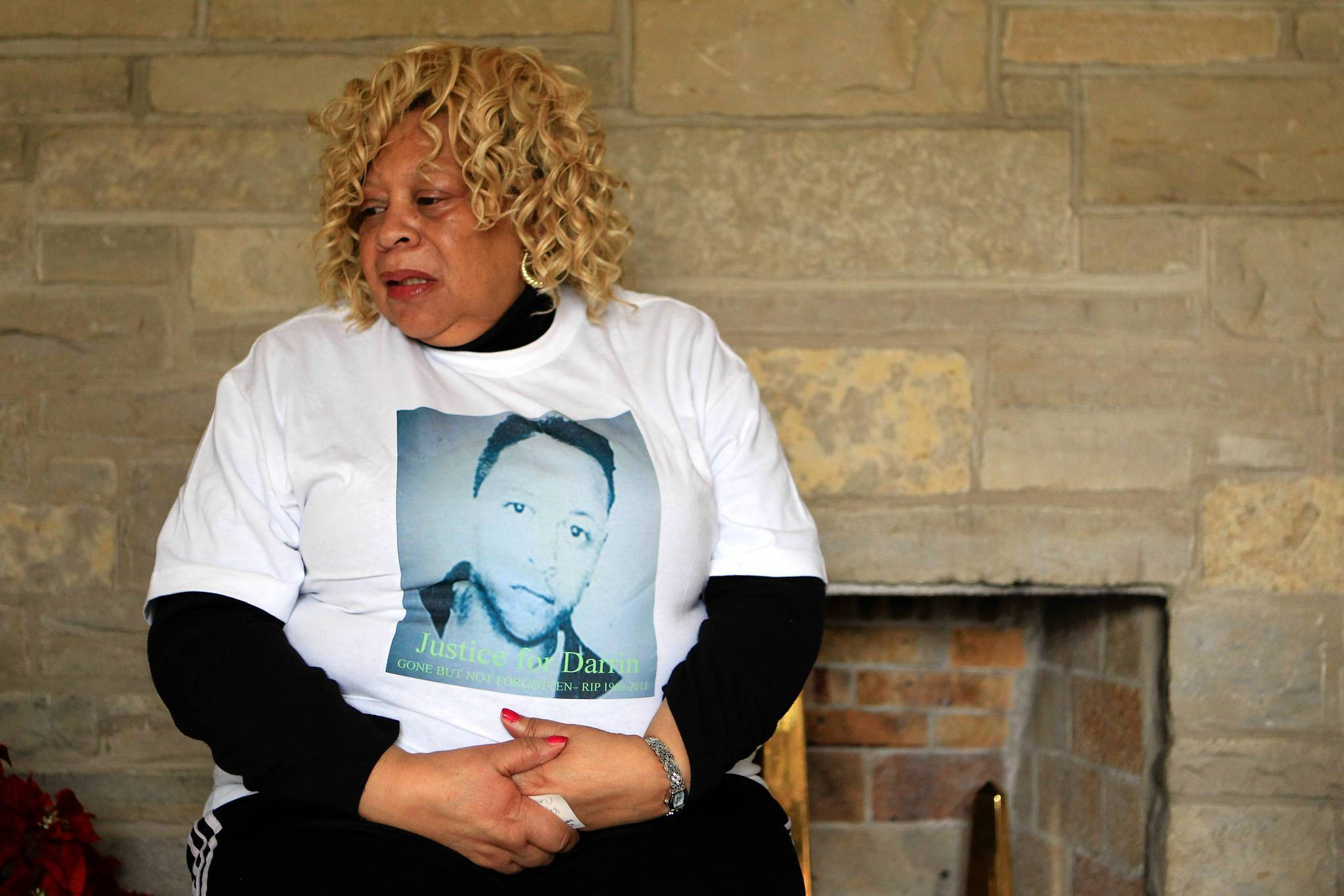 Gloria Carr, mother of Dannin Hanna, wears a shirt honoring her son in 2011.
