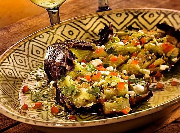 The taverna Kuzina reinvents a traditional salad, butterflied roasted eggplant.