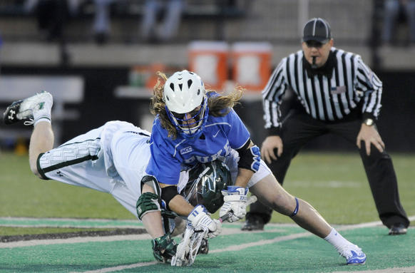 Loyola's Graham Savio, left, and Duke's Brendan Fowler compete for a faceoff in the first half.