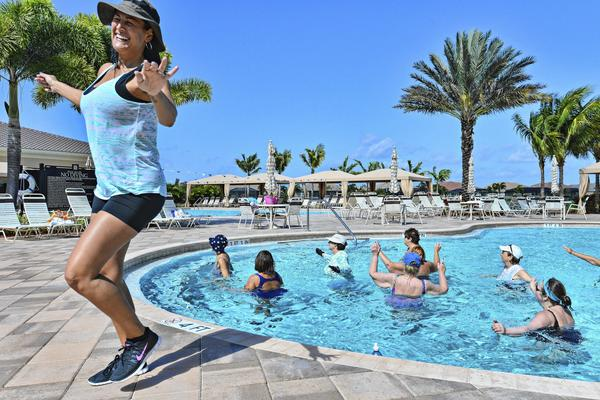 Deniece Morse teaches water aerobics at Gl homes Valencia Reserve in Boynton Beach, a 55- and-older complex.