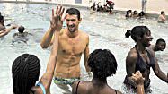 Pictures: Michael Phelps gives swim lessons to city students