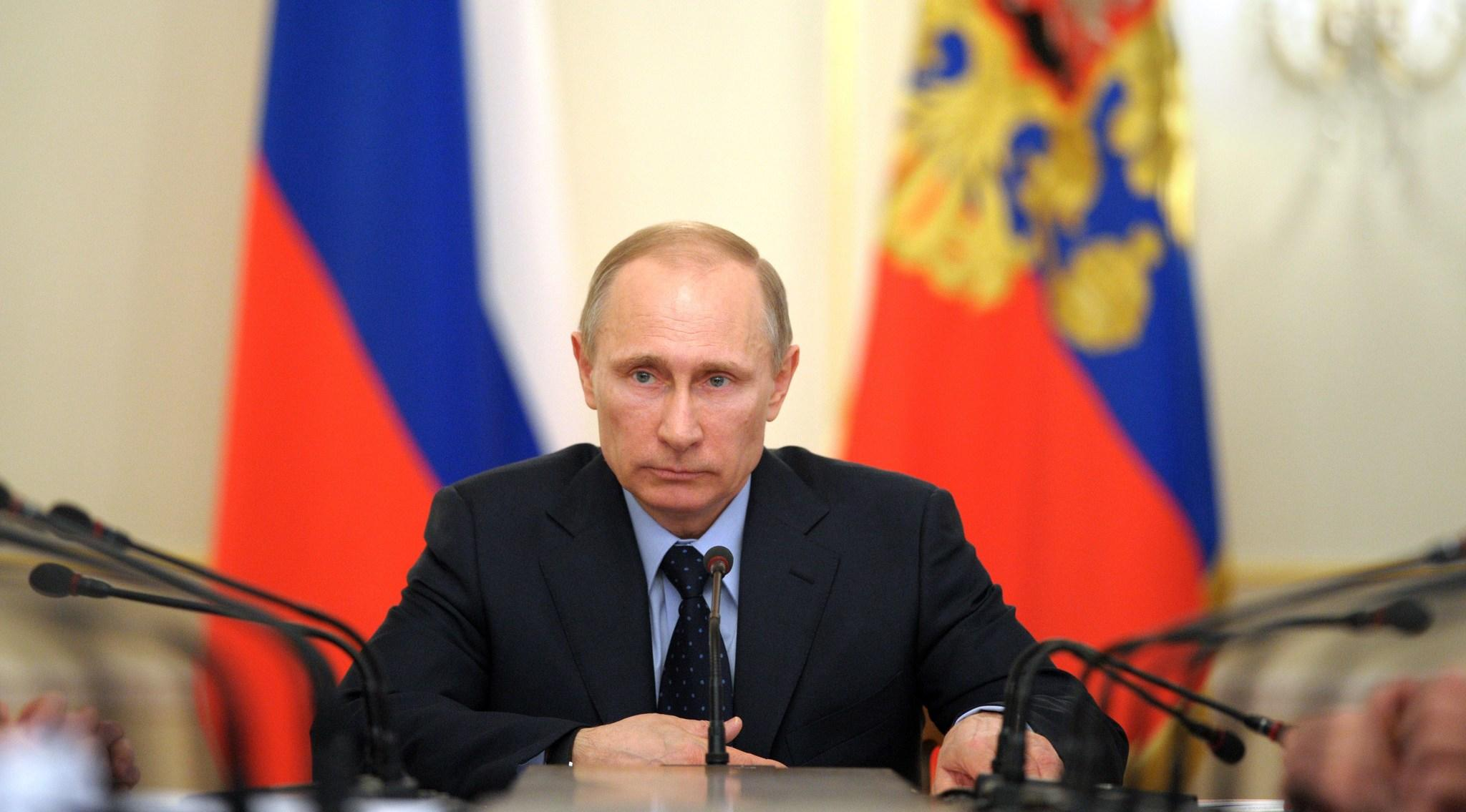 Russia's President Vladimir Putin (C) chairs a government meeting in his Novo-Ogaryovo residence, outside Moscow.