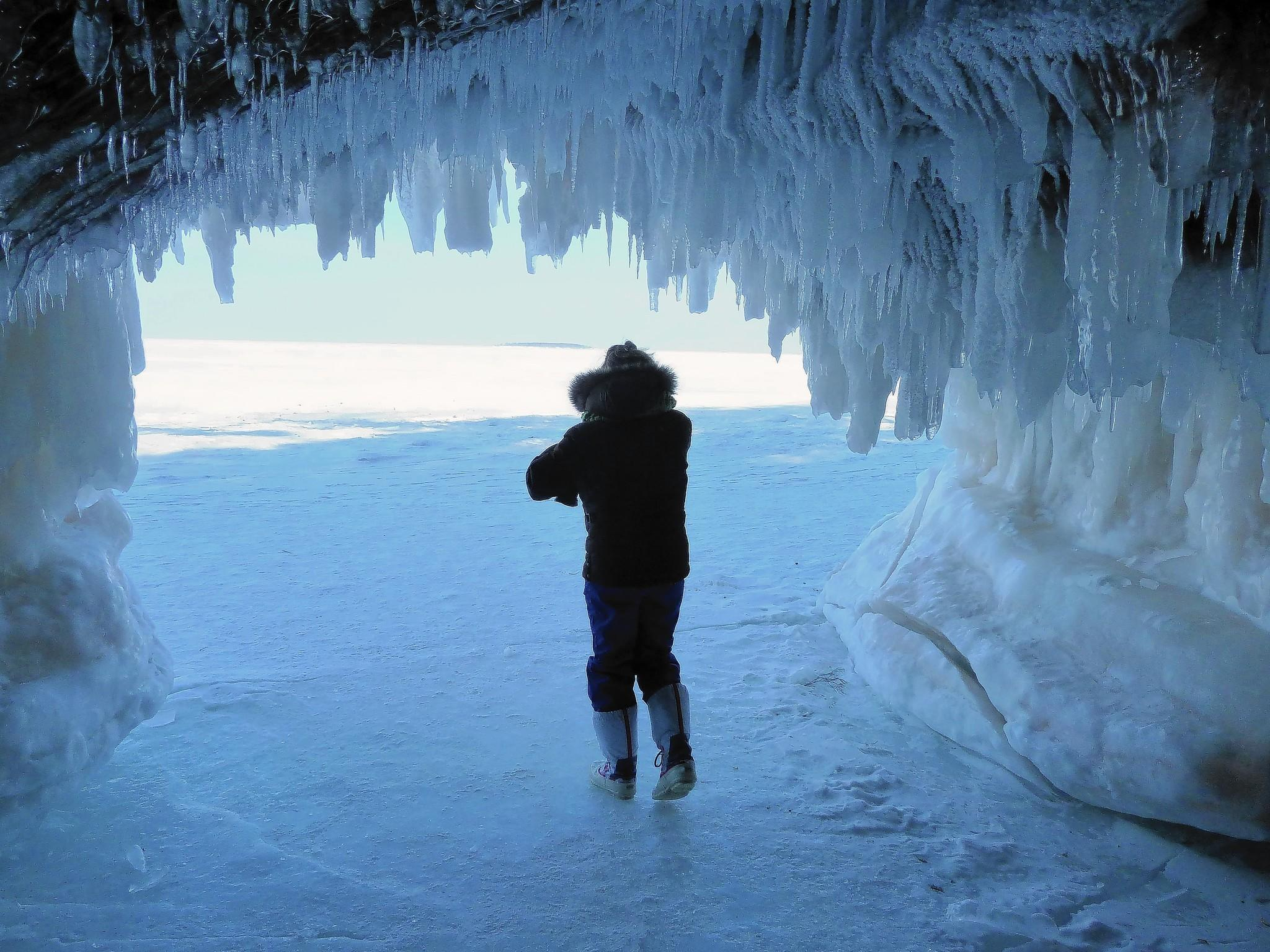 Patti Heil of Bloomington, Minn., is among hordes of tourists visiting frozen sea caves near Cornucopia, Wis. The normally inaccessible caves can be reached on foot thanks to a record-setting ice cover on the Great Lakes.
