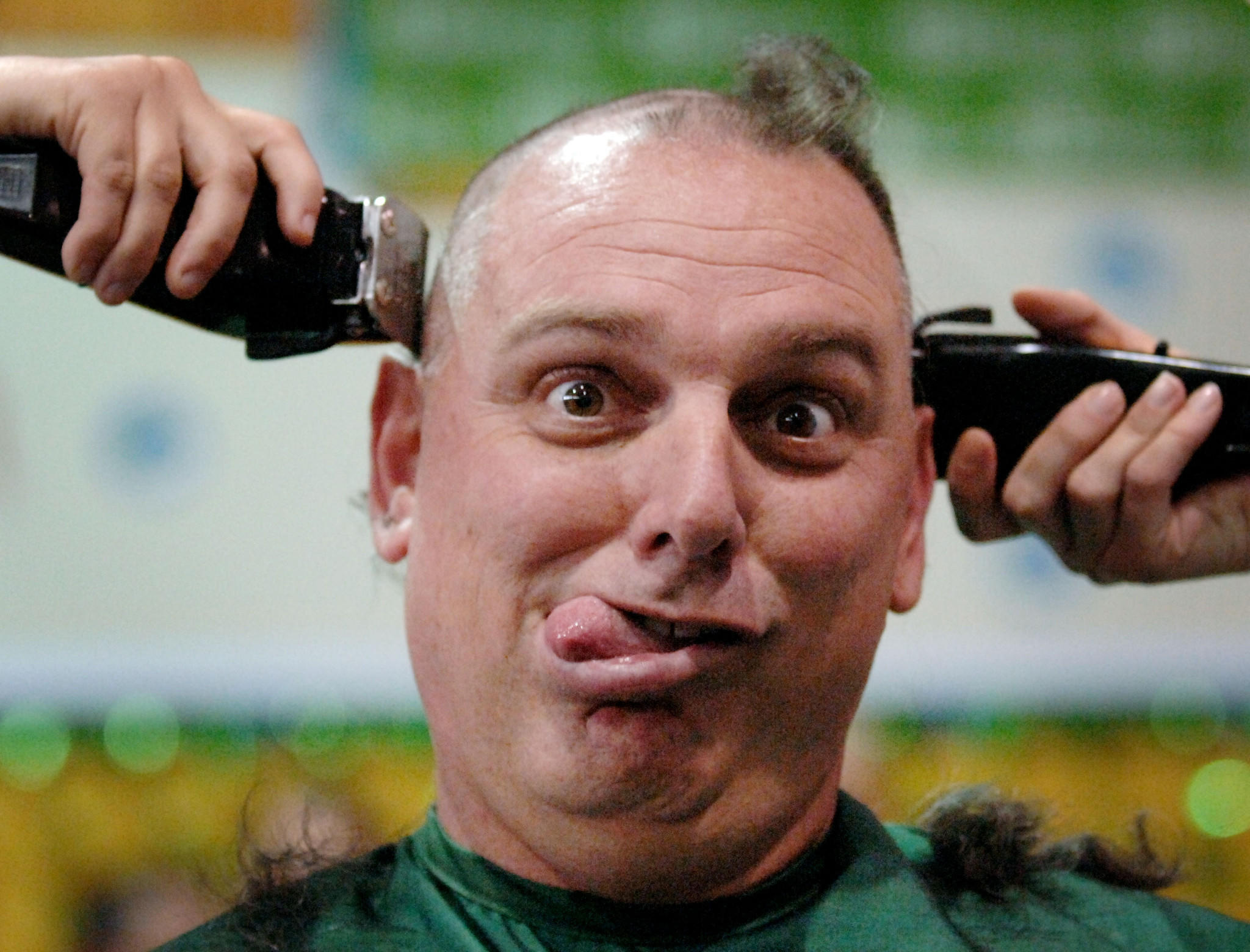 NO USE EXCEPT SUN SENTINEL; NO SHARING; NO RIGHTS (mr)flpbaldricks0404a, Boca Raton, 4/4/2008 -- Olympic Heights High School Principal Peter Licata makes a face at photographers while having his head shaved at the school's 4th annual St. Baldricks's Foundation Shaving the Way to Conquer Kids' Cancer event Friday. Fourteen staff members and about 75 students took part and had their heads shaved to raise money for the organization that raises money for childhood cancer research. This years event at Olympic Heights is estimated to raise as much as $30,000. Staff Photo By Mark Randall ORG XMIT: S-S0804041200262723