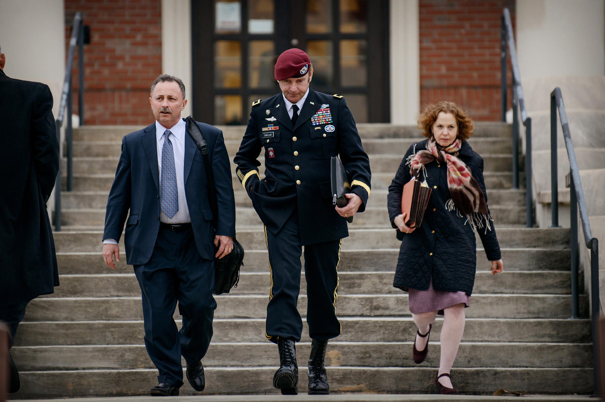 Brig. Gen. Jeffrey Sinclair leaves the courthouse on March 4 with his lawyers Richard Scheff, left, and Ellen C. Brotman.