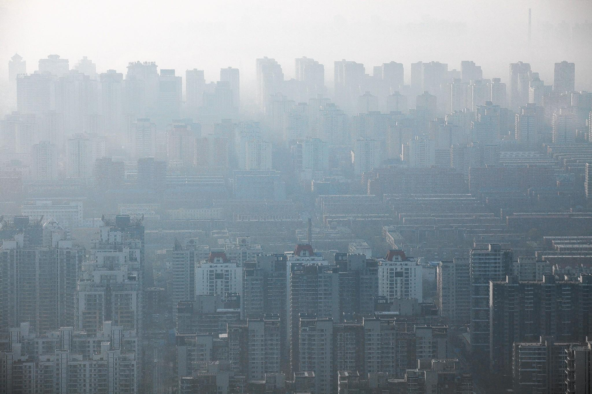 A view of the Beijing skyline in December. The Chinese and their architects are putting up skyscrapers, Chicago-style. But they're not building cities, Chicago-style. Traffic and pollution have gotten out of control.