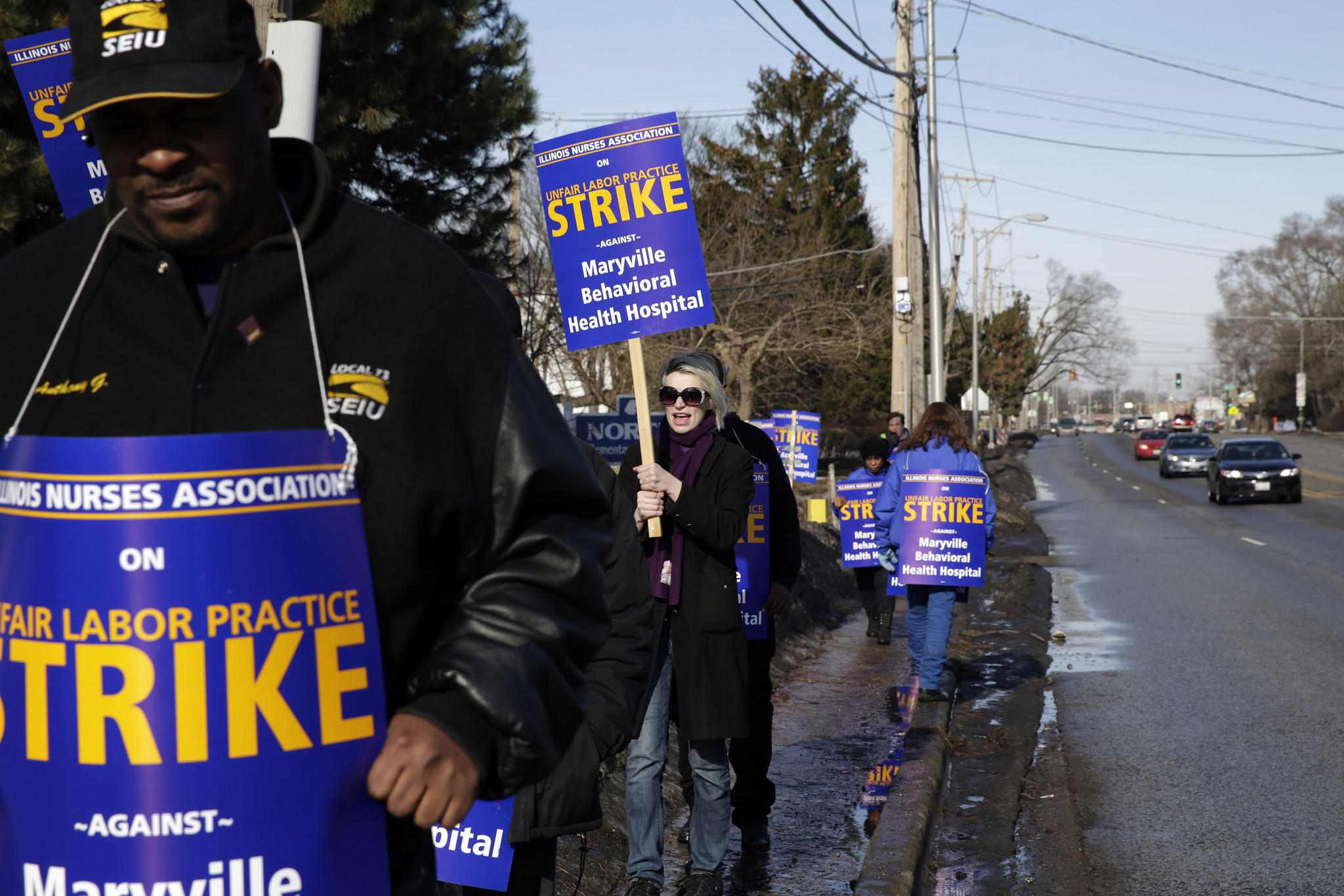 Nurses and strike supporters picket outside of Maryville Academy Behavioral Health Hospital in Des Plaines.