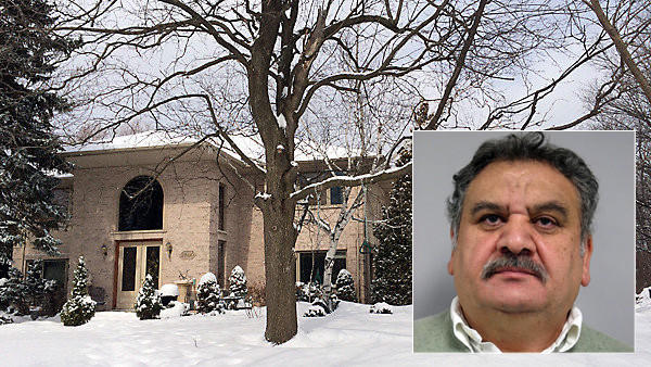 Branko Bogdanov (inset), his daughter and wife were arrested at their Northbrook residence on March 4.