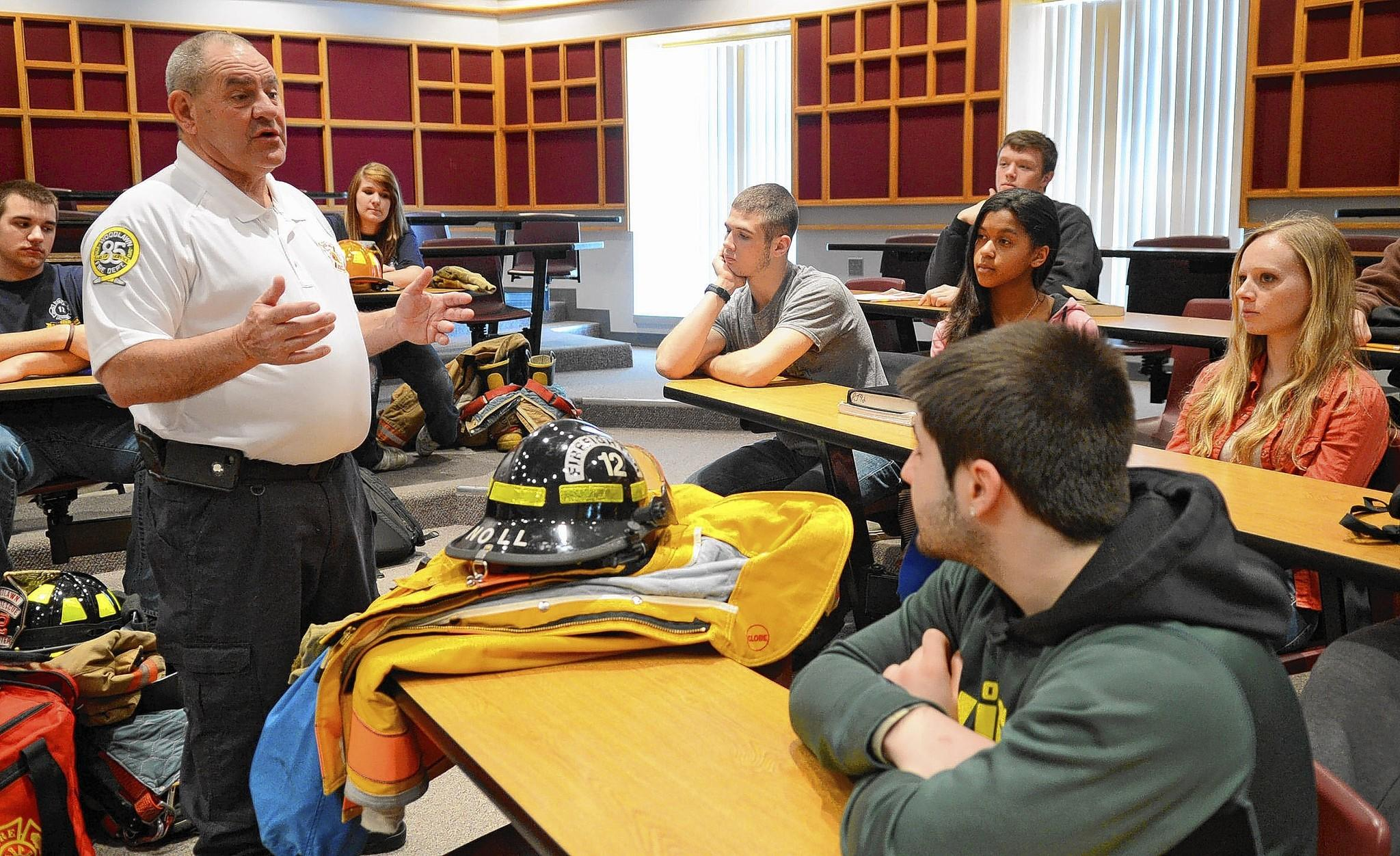 Retired teacher and firefighter Barry Search talks to students in Parkland High School's Science of Firefighting class. Search started the class in 1999, but it was eventually halted due to a lack of interest. This school year, he returned to help start it up again.