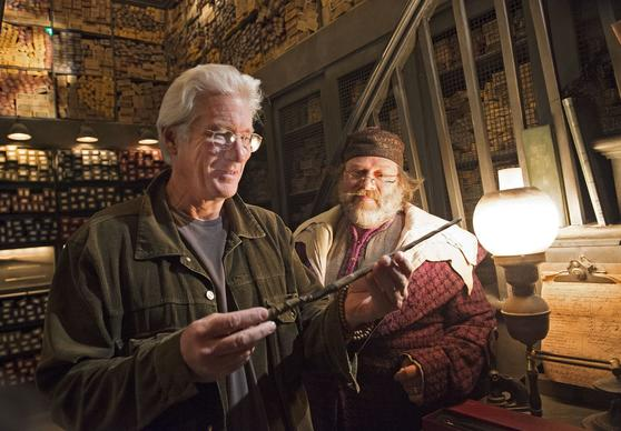 Golden Globe award-winning actor Richard Gere visited Ollivanders wand shop at The Wizarding World of Harry Potter ¿ Hogsmeade at Universal Orlando Resort on March 8, 2014.