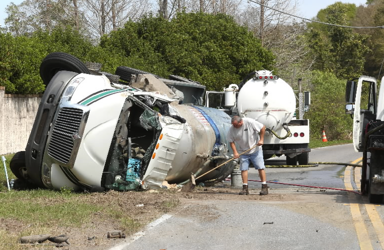 A truck carrying sewage from portable toilets flipped over this morning on West Lake Butler Road in Windermere. The driver was not injured and joined in the clean up that kept the road closed for several hours.