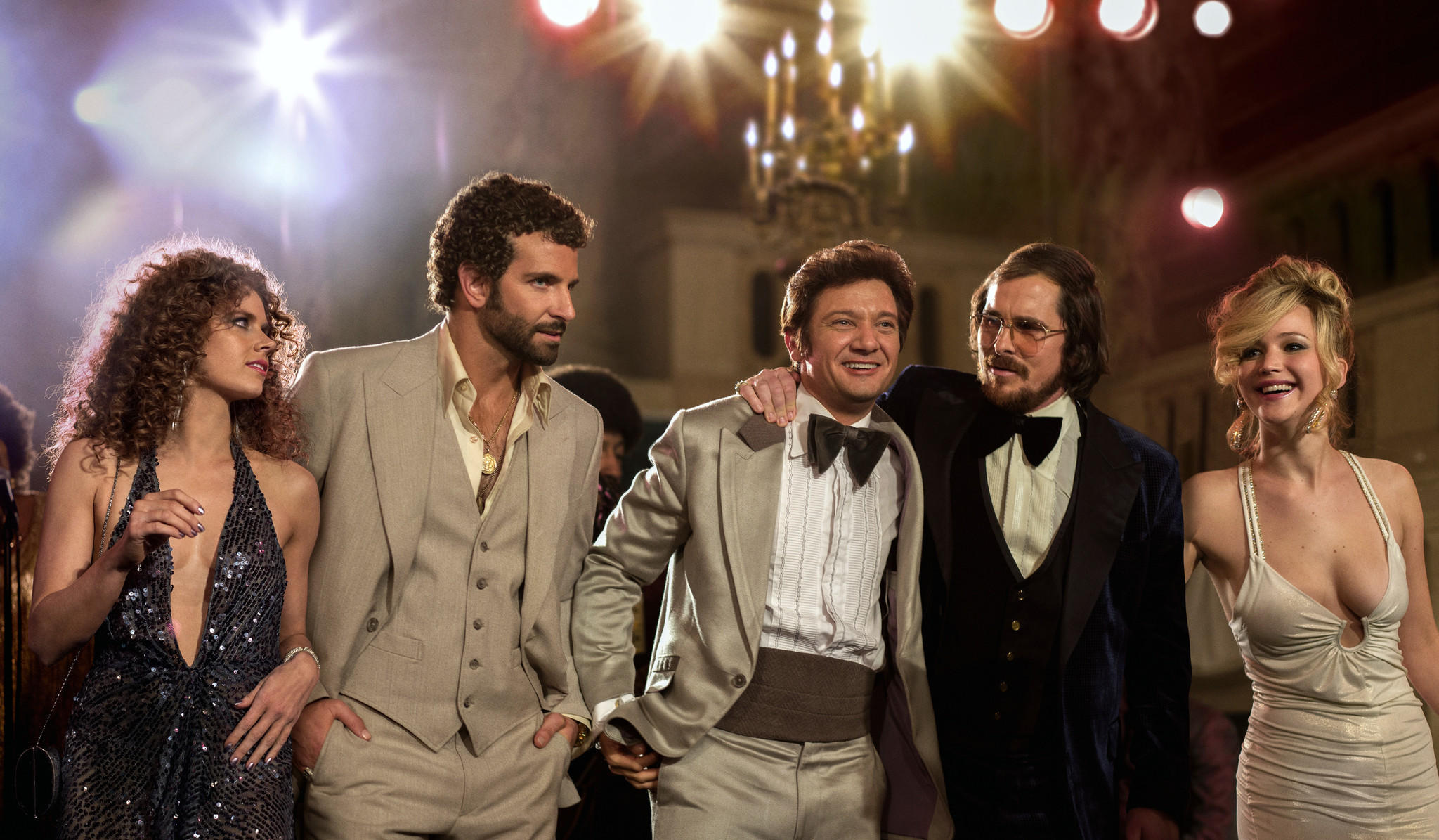 "Comcast this week will begin selling through its electronic store movies from Sony Pictures Entertainment, including ""American Hustle,"" starring (from left) Amy Adams, Bradley Cooper, Jeremy Renner, Christian Bale and Jennifer Lawrence."