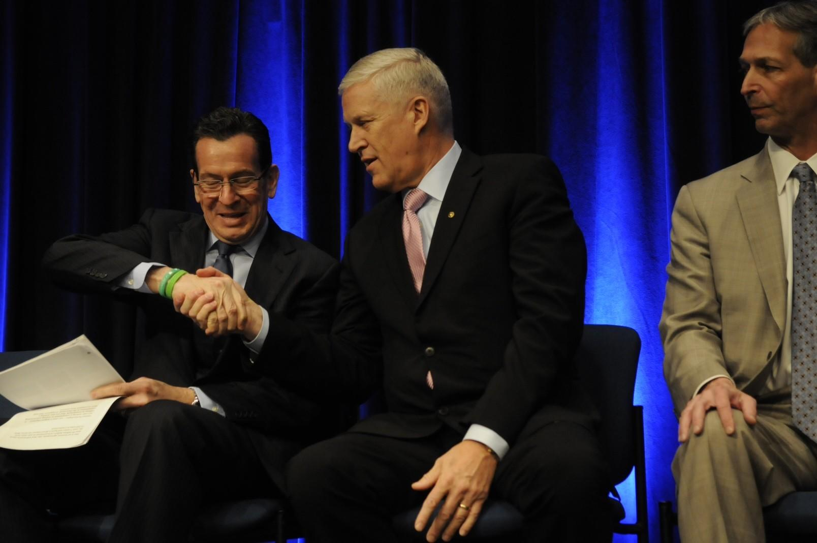 UTC's CEO, Louis Chnevert, shakes Gov. Malloy's hand at Wednesday's press conference.