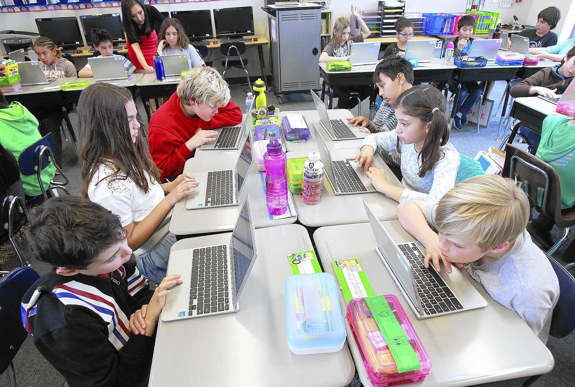 Students in Jennifer Chen's fifth-grade class work on Chromebooks during class at El Morro Elementary on Tuesday.