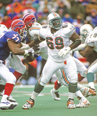 Miami Dolphins guard Keith Sims prepares to block during the Dolphins 37-22 loss to the Buffalo Bills in the 1995 AFC Wild Card Playoff Game on December 30, 1995 at Rich Stadium in Orchard Park, New York.