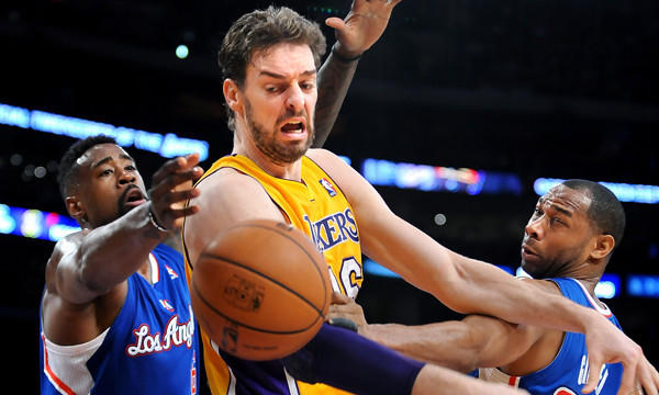 Lakers center Pau Gasol, middle, loses control of the ball while being double-teamed by Clippers center DeAndre Jordan, left, and guard Willie Green during the Lakers' blowout loss Thursday. Inconsistent performances in recent games makes it somewhat difficult to decipher what the Lakers are capable of accomplishing in their final 18 games.