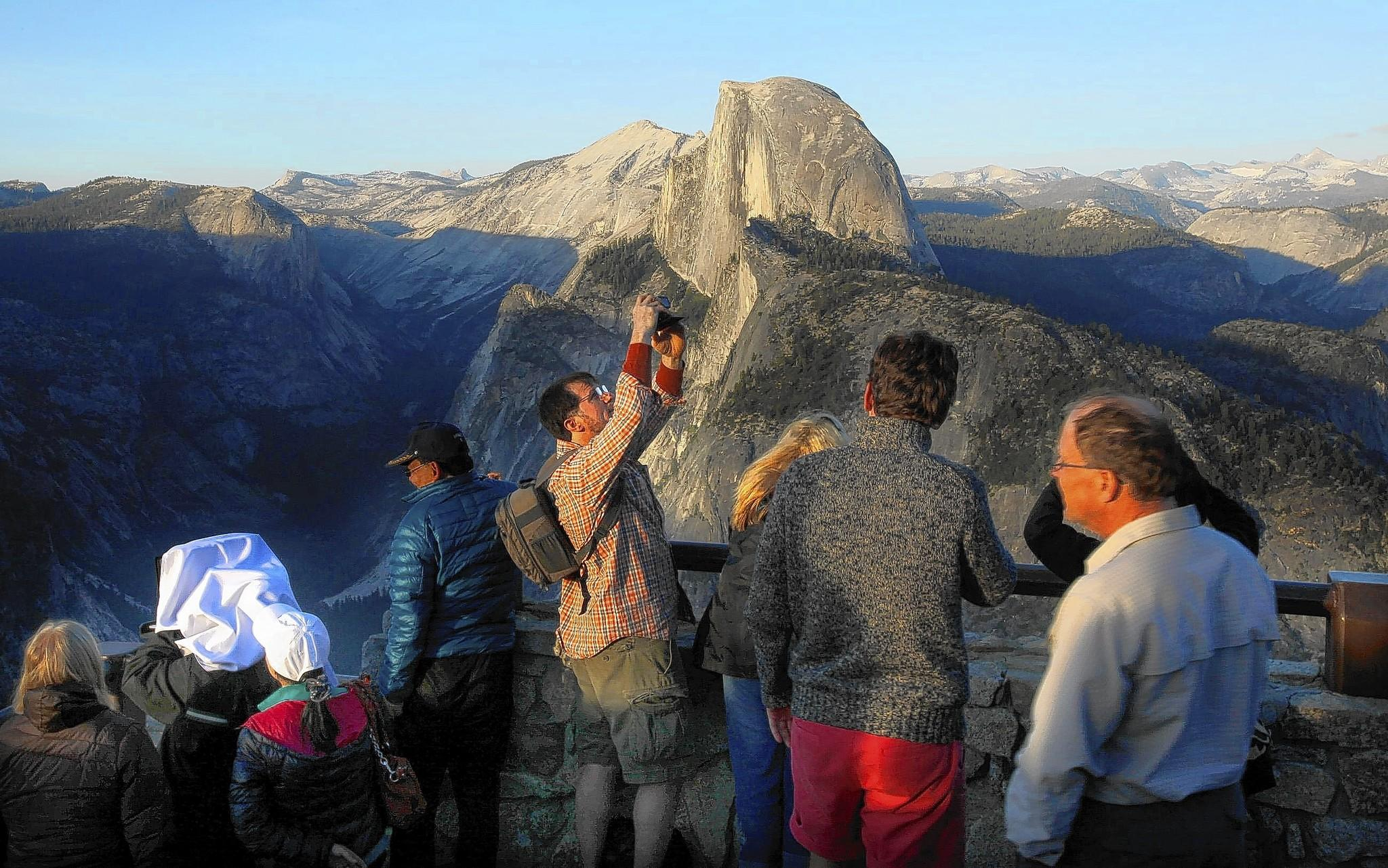 Visitors to Glacier Point aim their cameras and their attention to the famous Half Dome in Yosemite National Park in May 2013.