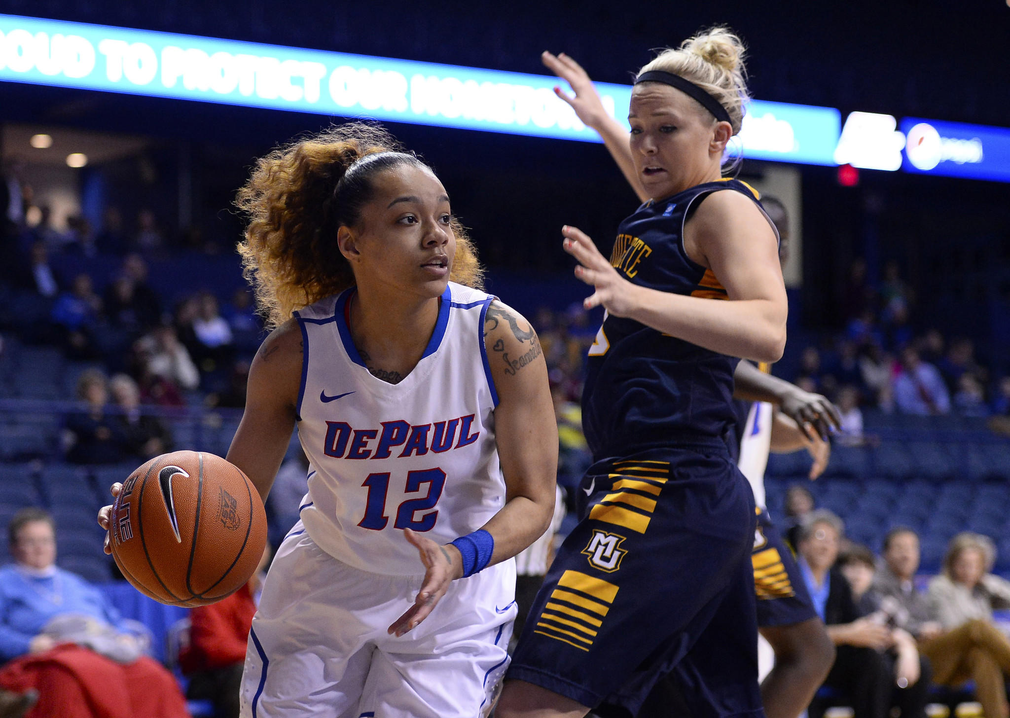 DePaul's Brittany Hrynko dribbles the ball against Marquette's Brooklyn Pumroy during the first half at Allstate Arena.
