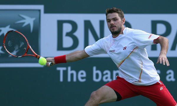 Stanislas Wawrinka lunges to return a shot during his win over Andreas Seppi at the BNP Paribas Open at Indian Wells on Monday.