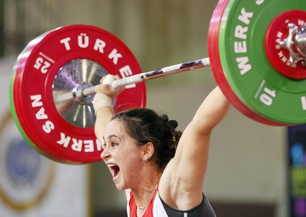 Romela Begaj of Albania competes in the women's 58kg weightlifting competition at the World Weightlifting Championships in Antalya, southern Turkey.
