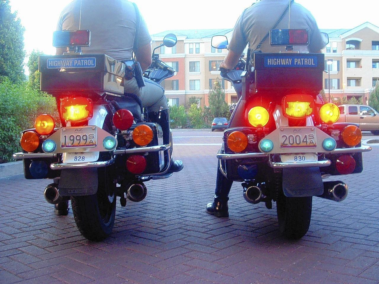 Motorcyle escort to airport in Phoenix in 2004. UConn men won titles in 1999 and 2004. When they pulled out of Phoenix they were headed to the Final four and the license plate proved prophetic for men and women, each of whom won the title in 2004. Click here to see the Courant's coverage of the wins.