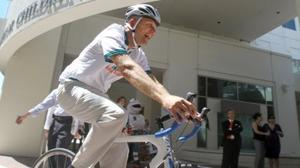 Dolphins CEO rides his bike for fun, fitness