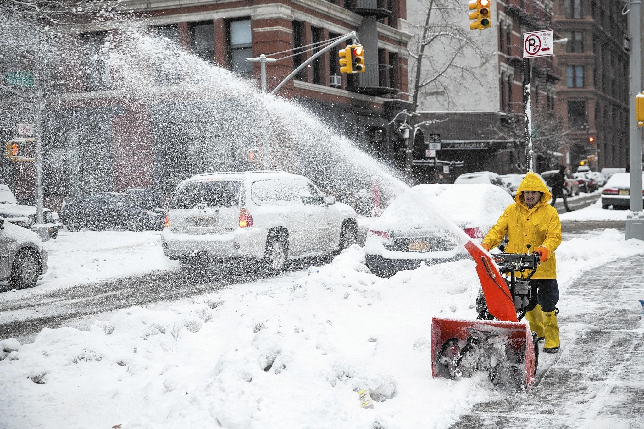 A man uses a snow blower to clear a sidewalk on February 18, 2014 in New York City. The city was hit with its 22nd day of snowfall, making for a total of 48 inches for the year.