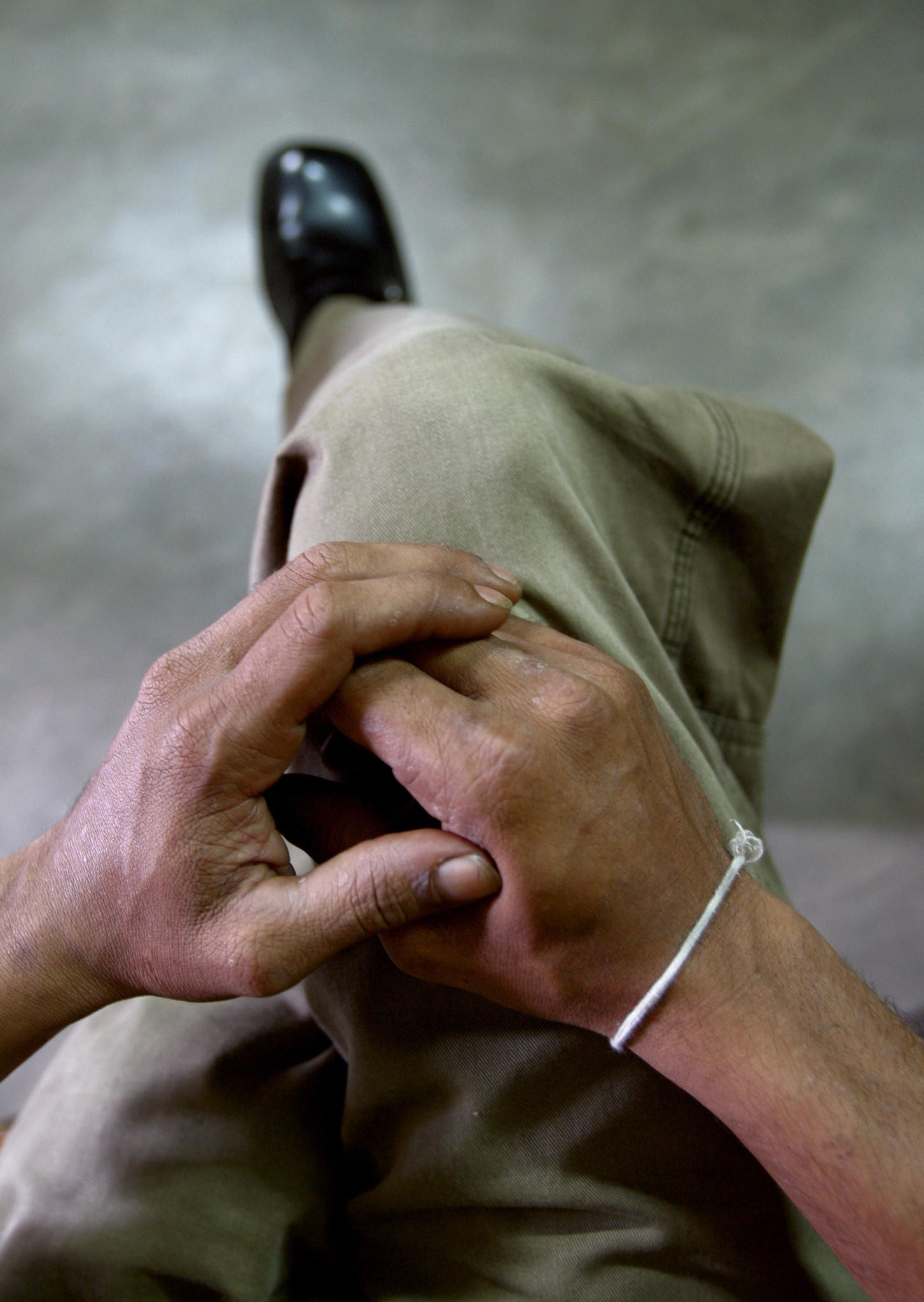 Then-Sri Lankan hangman Suranimala clasps his hands as he talks to Reuters about the reintroduction of the death penalty at a Walikada prison in Colombo, Sri Lanka in this picture taken December 6, 2004. In 2014 Sri Lanka is searching for a new hangman, as the most recent hire quit after seeing the gallows for the first time.