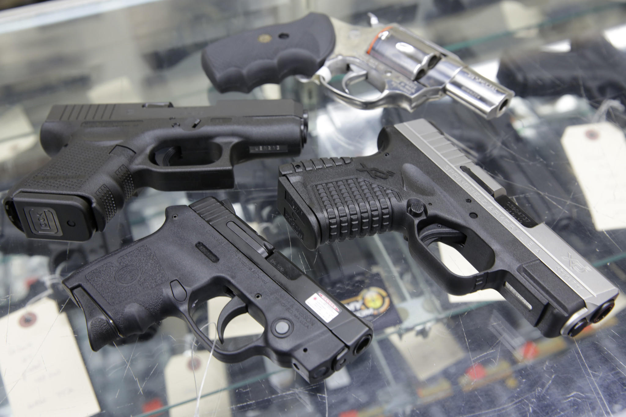 Popular handguns for concealed carry, including the Rossi 352 38 Special  P revolver, Springfield XD-S 9mm, Smith & Wesson Bodyguard 380, andGlock 26 Gen4 9mm, clockwise from top, on display at Article II Gun Shop and Range, 250 Cortland Ave., in Lombard.