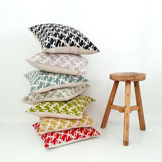 "All single-sided cushion covers by South African textile designer <a href=""http://skinnylaminx.com/2014/03/11/stacks-of-stock-sale-now-online/""> Skinnylaminx</a> are 50% off through March 15."