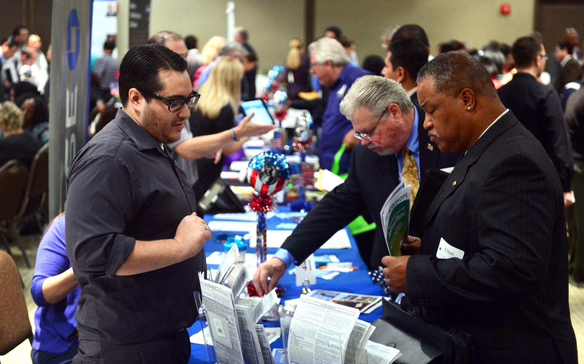 Prospective job seekers meet at a hiring event in Van Nuys.
