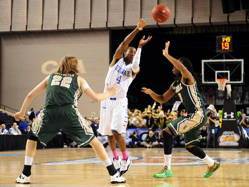 Mar 10, 2014; Baltimore , MD, USA; Delaware Blue Hens guard Jarvis Threatt (4) passes the ball over William and Mary Tribe guard Marcus Thornton (3) in the second half during the championship game of the Colonial Athletic Conference basketball tournament at Baltimore Arena. Mandatory Credit: Evan Habeeb-USA TODAY Sports