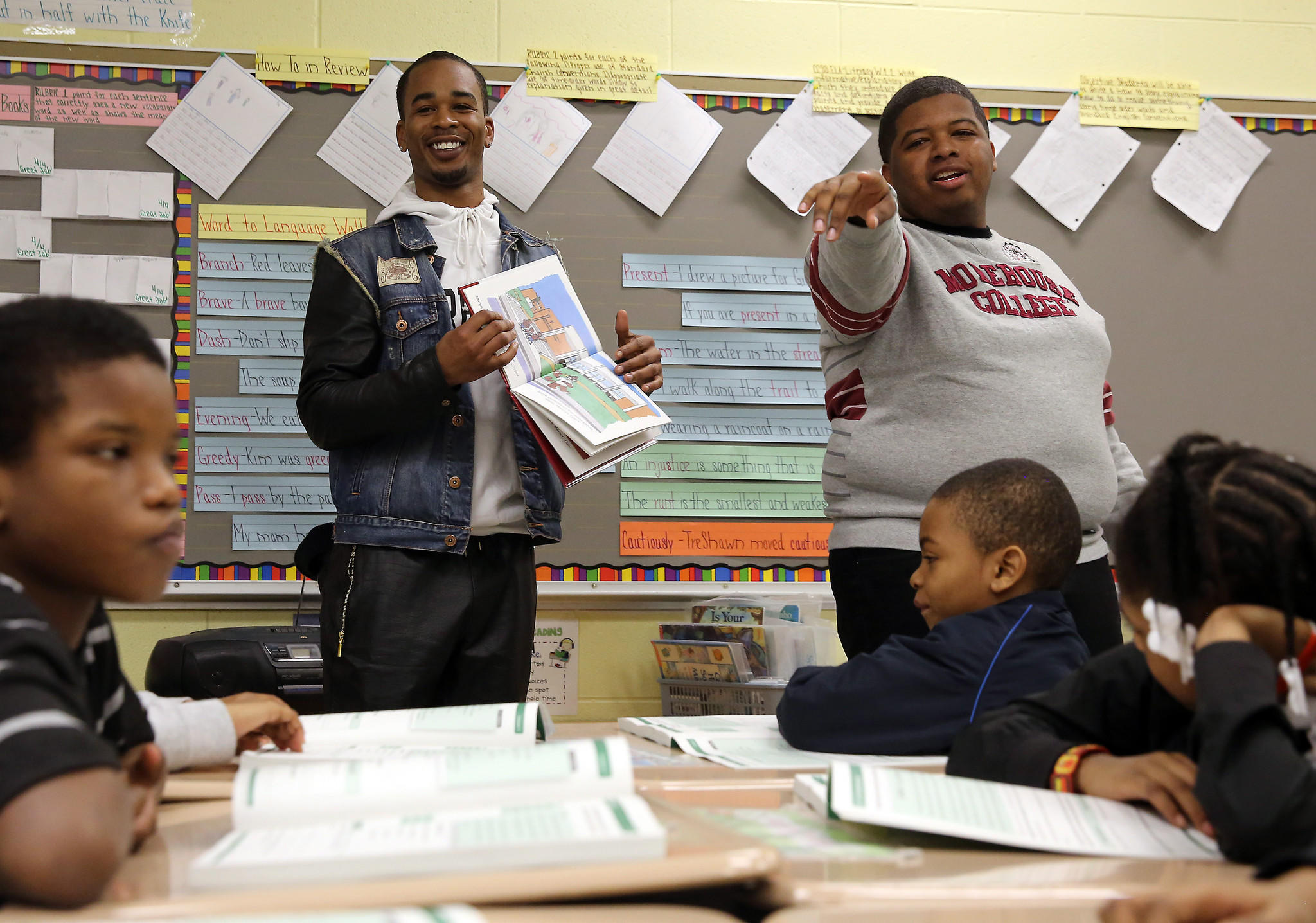 Morehouse College students Shawn Tomlinson, left, and Corey Hardiman read to children at Lavizzo elementary school.