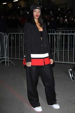 Rihanna wore a baggy pants suit by designer Riccardo Tisci to the Givenchy show.