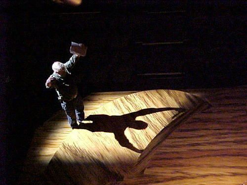 """Christen tinkering with a light cue on the set of the Goodman Theatre's """"The Gift Horse"""" in 2002"""