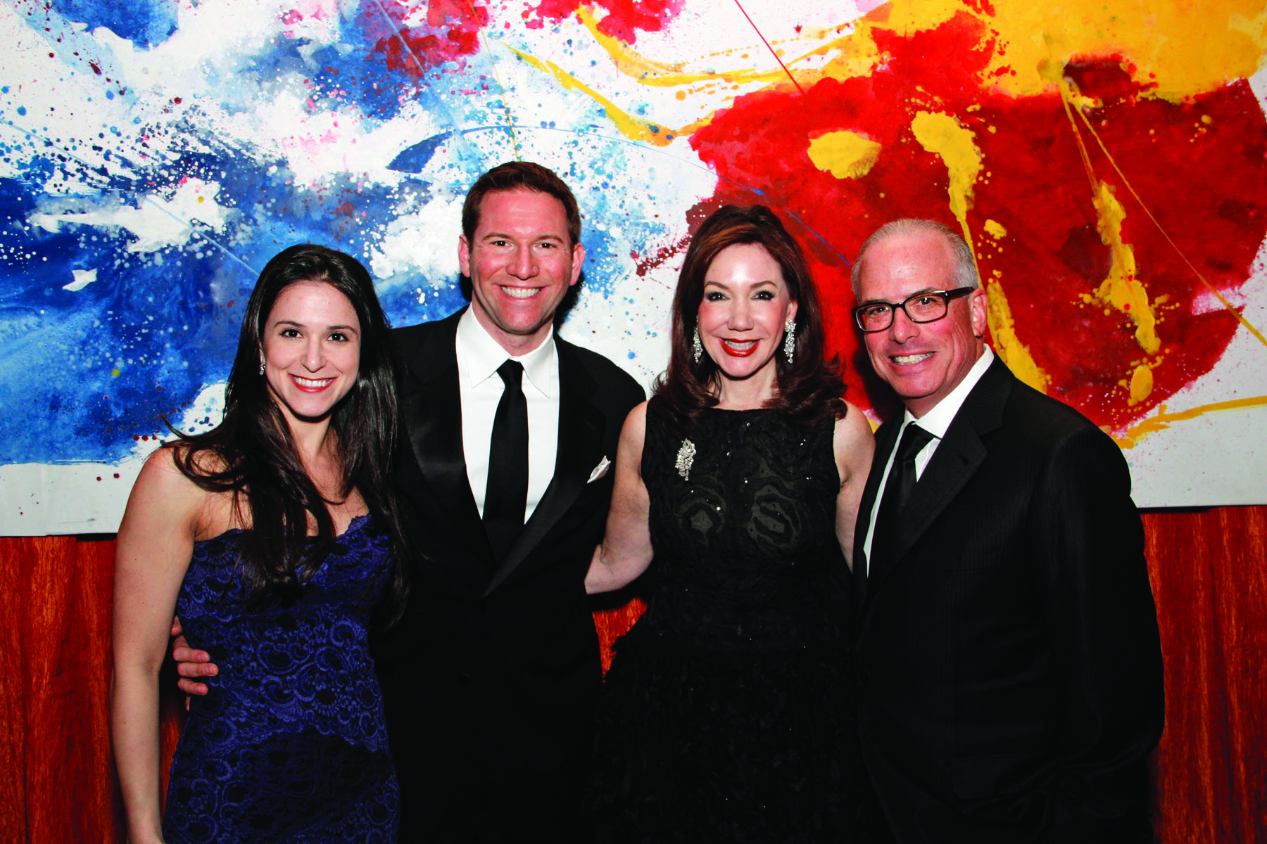 Society Scene photos - Against a colorful backdrop, Hali Utstein, left, David Silvers, Laurie Silvers and Mitchell Rubenstein set the tone for a fun evening at the Raymond F. Kravis Center for the Performing Arts