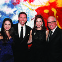 Against a colorful backdrop, Hali Utstein, left, David Silvers, Laurie Silvers and Mitchell Rubenstein set the tone for a fun evening at the Raymond F. Kravis Center for the Performing Arts' annual black-tie gala.