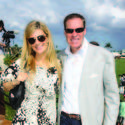 "Mia Matthews, left, and Bob Matthews recently enjoyed the festivities of Caridad Center's ""Champagne, Hors d'oeuvres and Polo"" reception at the International Polo Club."