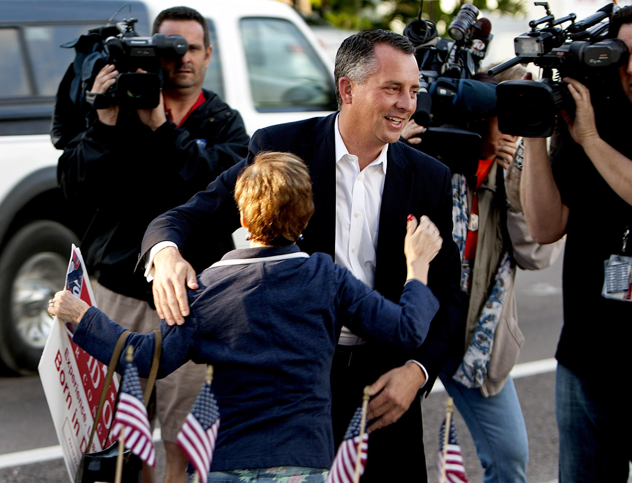 Candidate David Jolly greets supporters as he arrives at the Indian Shores Town Hall to place his vote in the special election for Florida 13th Congressional District.