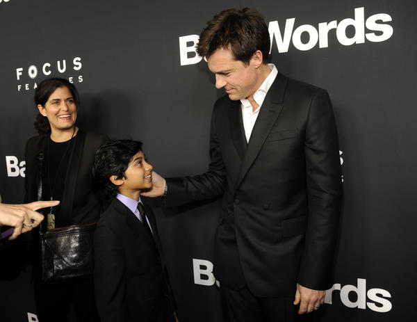 "Jason Bateman, right, director and a cast member in ""Bad Words,"" greets young cast member Rohan Chand at the premiere of the film on March 5, 2014, in Los Angeles."