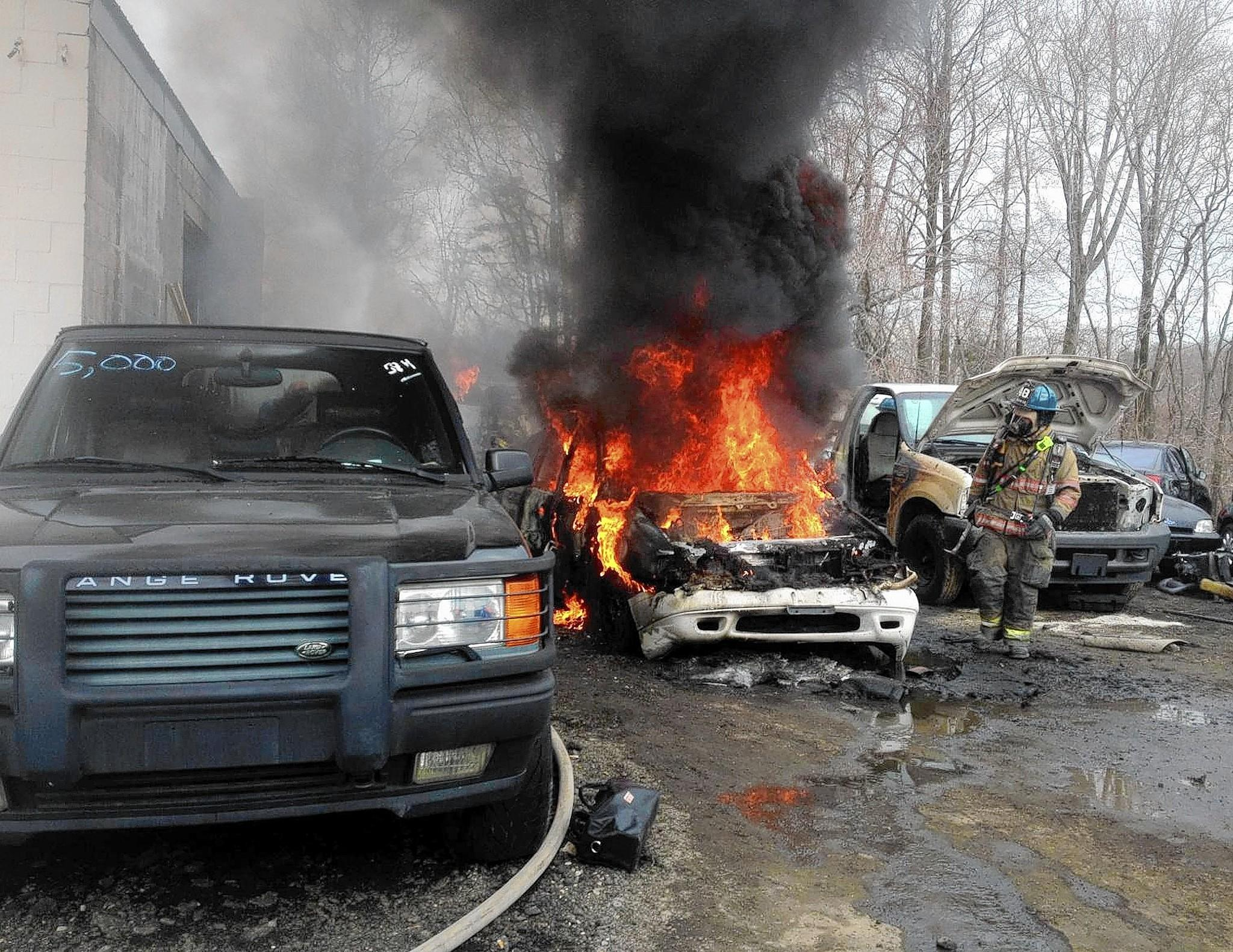 A car burns at Maryland Used Auto Parts. Firefighters from Harford and Baltimore counties were called to a fire that damaged two vehicles at an auto sales and service business in Joppa Monday afternoon.