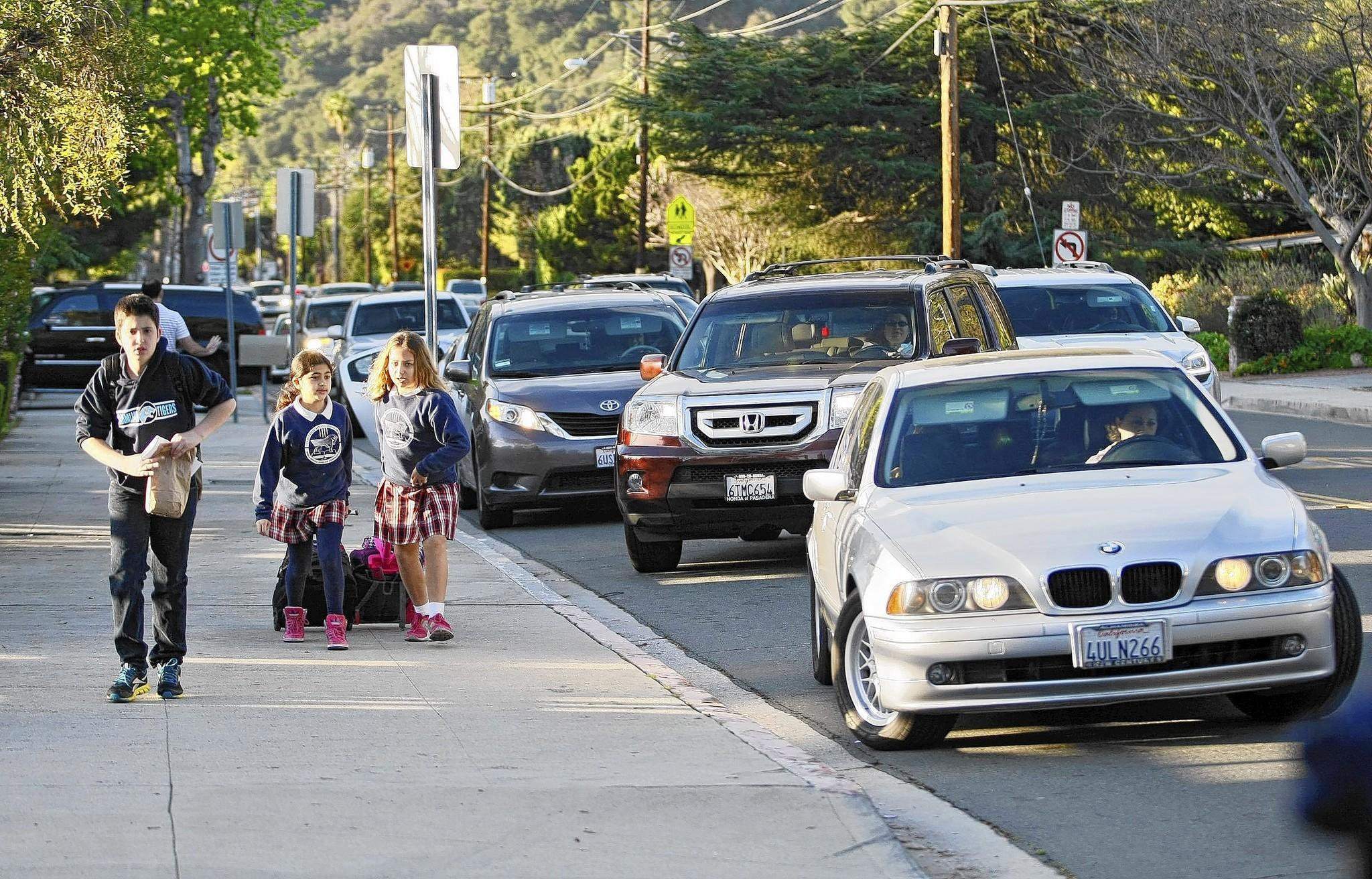 Parents in vehicles drop off their children at Chamlian Armenian School at about 8 a.m. on Tuesday, March 11, 2014.