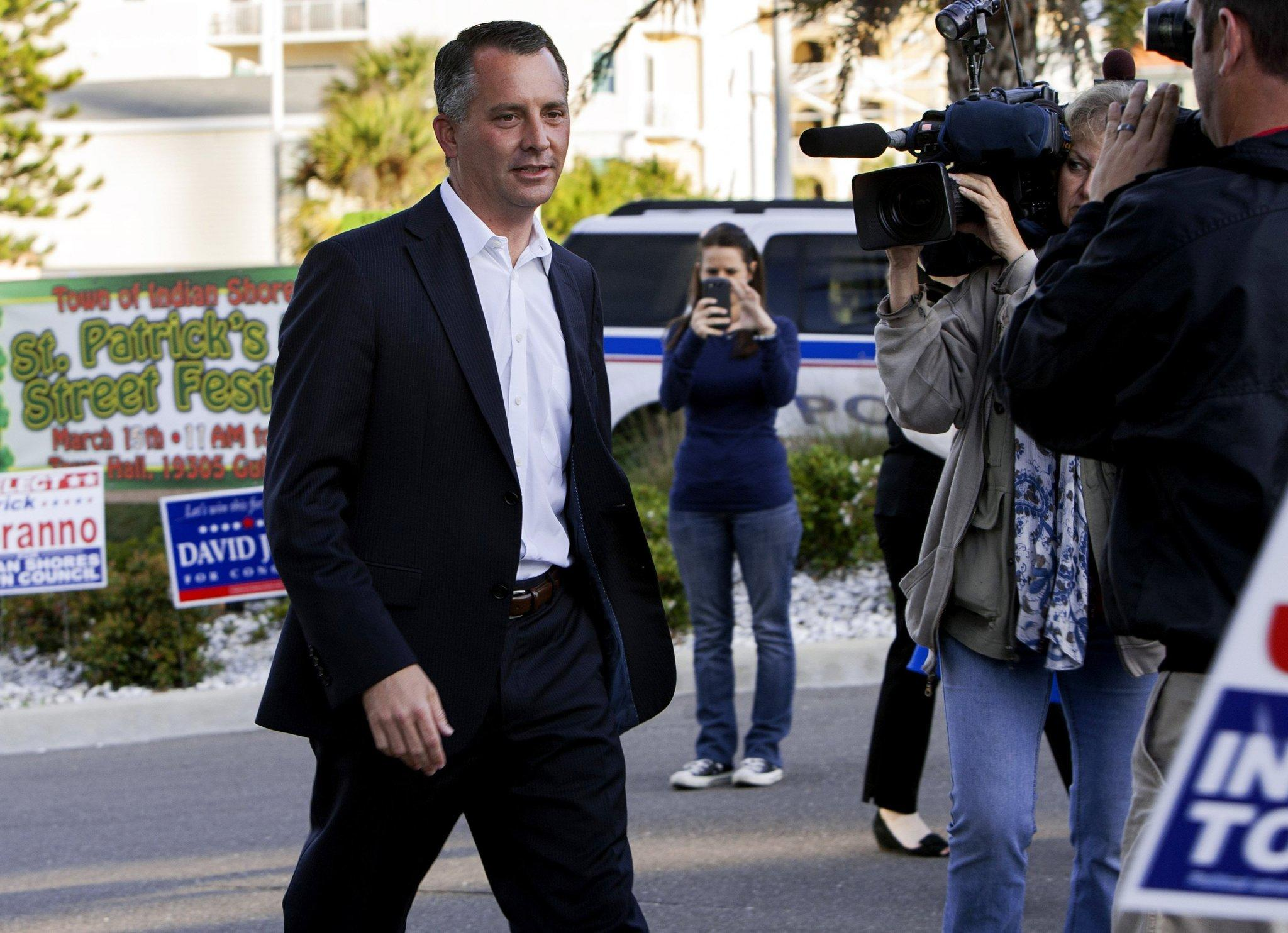 Republican candidate David Jolly arrives at the Indian Shores Town Hall in Indian Shores, Fla., to place his vote in the special election for Florida 13th Congressional District, Tuesday, March 11, 2014.
